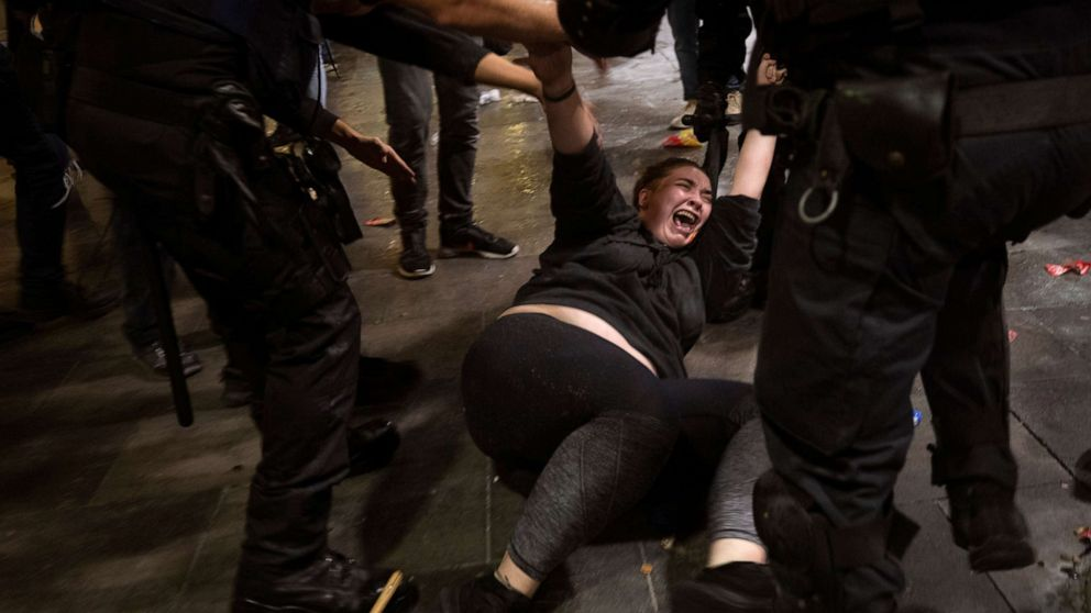 Violent protests erupt in Spain as Catalan leaders given lengthy prison sentences