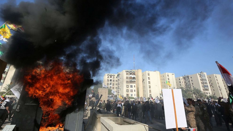 Iraqi mourners march on U.S. embassy to protest airstrikes
