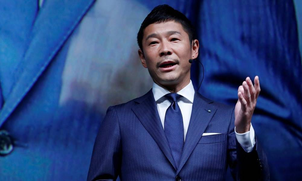 A Japanese fashion billionaire just pledged to give away $9 million on Twitter for a 'social experiment'