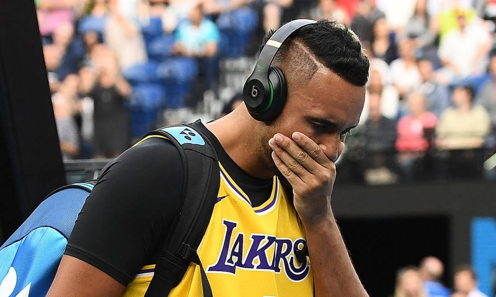 Nick Kyrgios walked into his match against Rafael Nadal wearing a Kobe Bryant jersey, covering his face and holding back tears