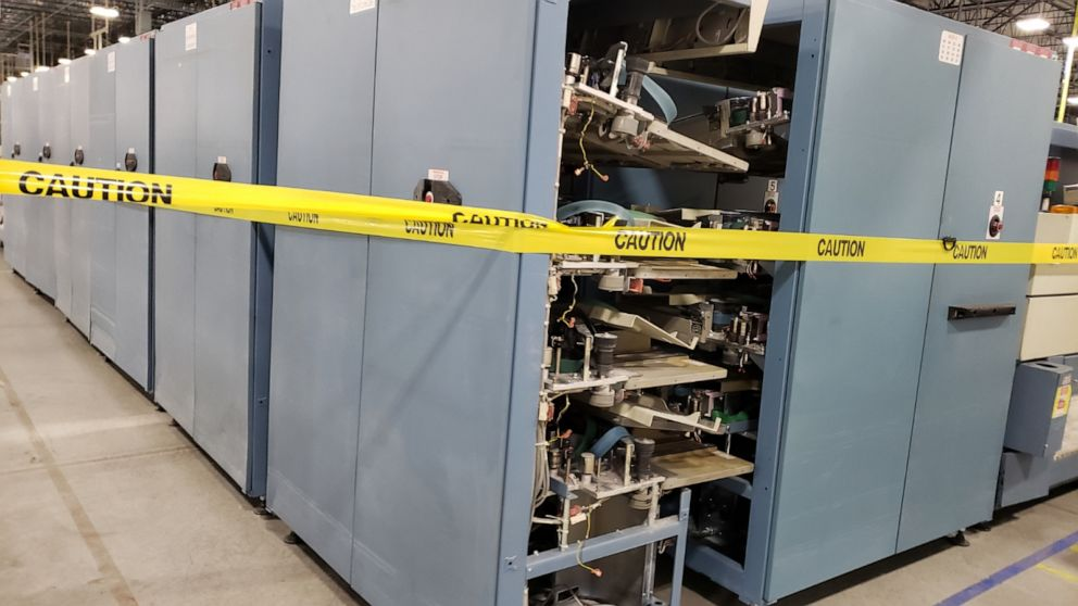 Photos appear to show mail sorting machines in parts in US postal facility