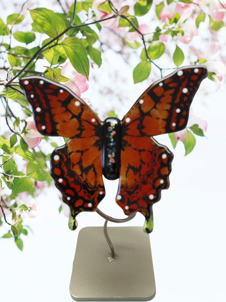 Reddish orange fused glass butterfly with metal stand. Handcrafted by DarteGlass, a woman owned company