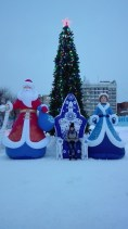 Tomsk: the Russian equivalent of Father Christmas, his granddaughter and me in the middle!