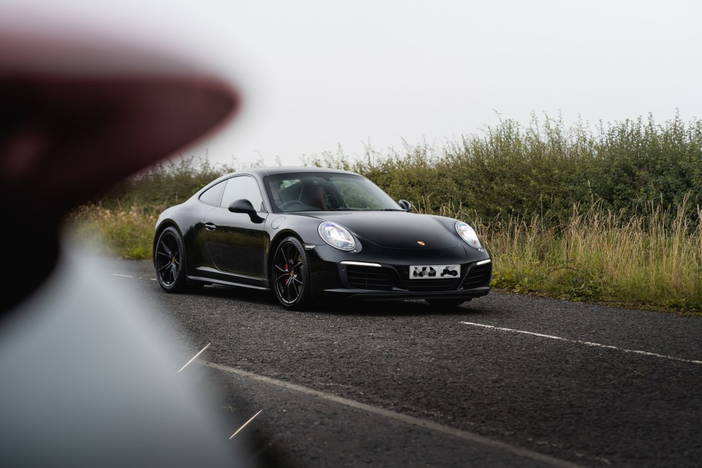 Porsche 911 front end on a country road