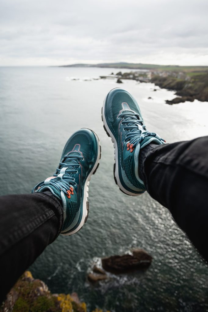 feet dangling off cliffs