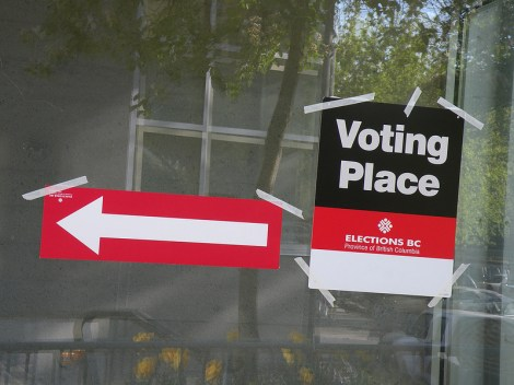 Sign points out a voting place. Photo: CC-BY-NC-ND -  Flickr - BlueAndWhiteAmy
