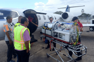 The Morgan Family is airlifted from San Juan to Miami. Credit: Emily Morgan.
