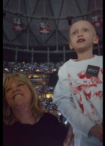 6-year-old Taylor Rayburn enjoying the Taylor Swift concert in Atlanta. Turns out that's Swift's mother, Andrea standing beside her.