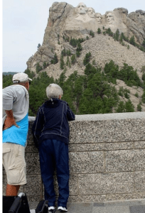 Norma and her son at Mt. Rushmore. Credit: Driving MIss Norma/FB