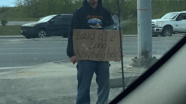 A stranger pays to get the cellphone turned back on for a man with a cardboard sign. He finds messages that there is work waiting for him.