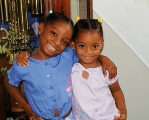 How adorable are Simone Biles and her little sister, Adria, taken shortly after they were adopted by their grandparents, Ron and Nellie Biles.