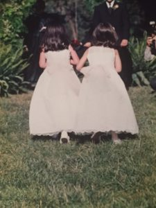 Cyndi's daughters as flower girls at a friend's wedding. One of the early from behind photos.
