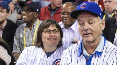 Comedian Bill Murray surprised a random fan by giving her his extra ticket to Game 6 of the World Series and letting her sit next to him. Karen Michel.