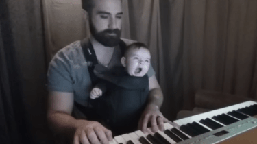 "David Motola, also known as, ""Bearded Piano,"" gets his baby Sam to sleep by playing Brahms' lullaby."