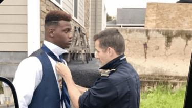 Pennsylvania Ambulance paramedic Jared Bryer helps teen tie his tie before prom.