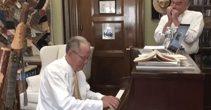 Senators Tim Kaine and Lamar Alexander hold a jam session getting ready to perform together.