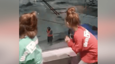 Fun, Southwest Airlines employee is caught on video dancing with two little girls waiting for a flight from Dallas to Oklahoma.