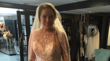 The mother of Waffle House shooting survivor buys wedding dress for waitress she believes saved her son's life.