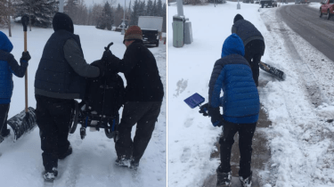 Strangers carry boy and his wheelchair through the snowy streets of Edmonton after mom struggles in the wet and heavy snow.