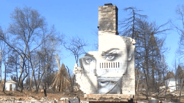 Mural artist Shane Grammer painted this image of hope on the remains of a friend's home that was destroyed in the Camp Fire.