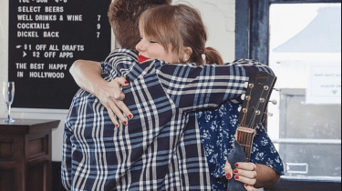 "Taylor Swift does a surprise serenade for a newly engaged couple who both love her song, ""King Of My Heart."""