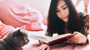 How to calm your cat with reading a book.