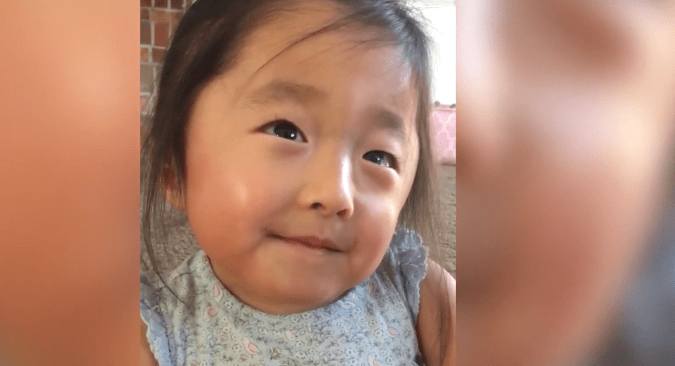 Lily's eyes beaming love at her mom tell her adoption story, even without words.