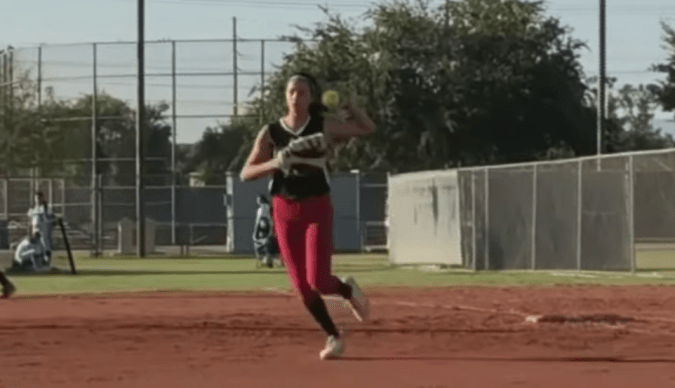 Kennedy rocks first base for her softball team. With this second cochlear implant, she'll soon be able to better hear her parents and friends cheering for her.