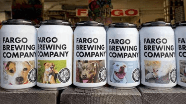 North Dakota brewery is putting the faces of some shelter dogs on beer cans to help them find forever homes.
