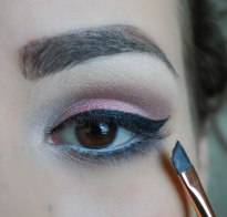 Create Cat eye, apply mascara and false lashes, they apply another coat of mascara and don't forget to conceal under the eyes :)