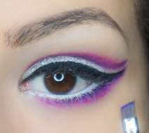 Come back with angled brush and purple shade and conect the cat line with lover lash line; UD Urban with SE11