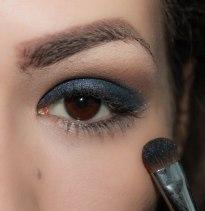 3. take glittery dark blue eyeshadow and apply in on the crease and blend it softly upwards; Brush- Sigma Eye Shading E55, Eyeshadow KIKO Infinity 410