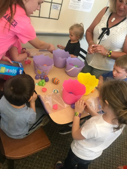 Children opening their eggs