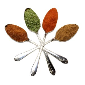 Fours spoons with spices in a star