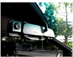 A closeup of the HDVR-150 car DVR installed on the rear view mirror car camera