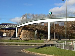 Clydeside Expressway pedestrian bridge with courier