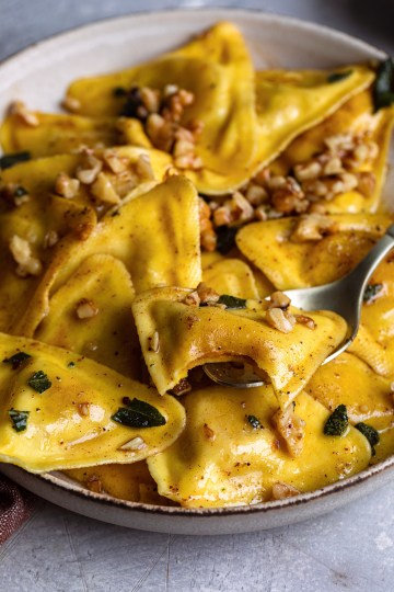 Trader Joe's butternut squash raviolis with a sage nutmeg butter sauce and toasted walnuts make for the perfect cozy and comforting meal!