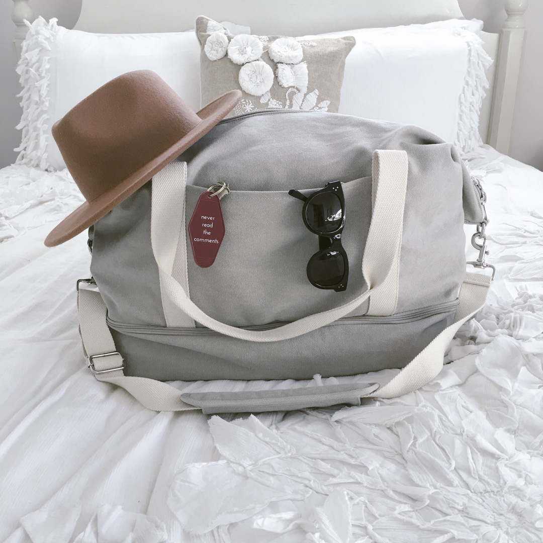 Packing tips from Dash Of Panache featuring a Lo and Sons Catalina Weekender Deluxe on an Anthropologie Florette duvet and Celine sunglasses