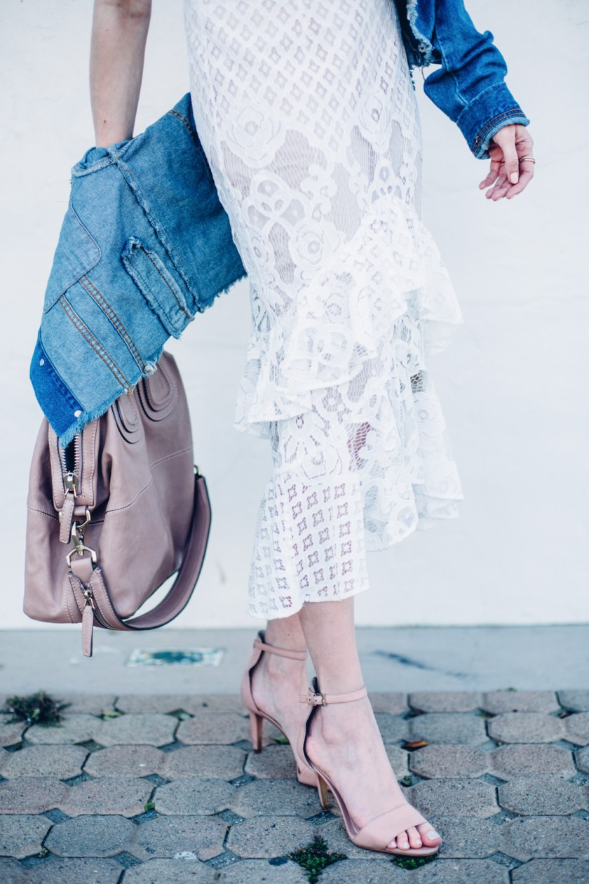 Jackie Roque styling a spring look in Malibu, wearing a Trouve Tiered Lace Midi Skirt, Trouve Surplice Cold Shoulder Bodysuit and a Market Miami denim jacket.