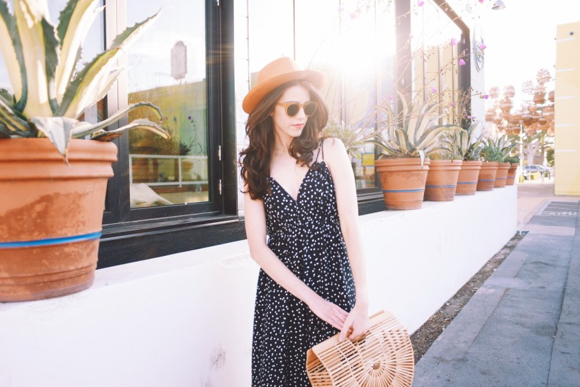 Jackie Roque styling a polkadot jumpsuit and knotted sandals in Malibu.