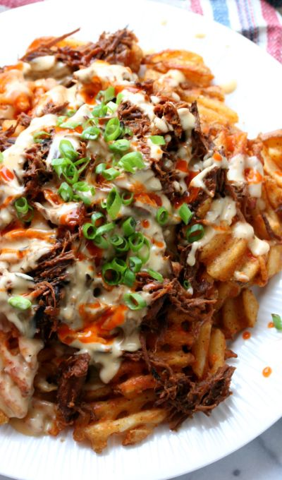 Beer Braised Pork, Waffle Cut Fries with Cheese Sauce