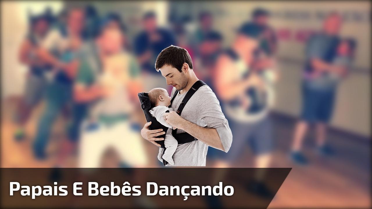 Papais e bebês dançando