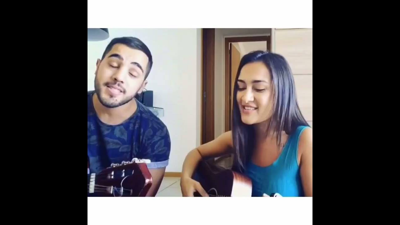 Casal cantando musica Trevo ANAVITÓRIA part