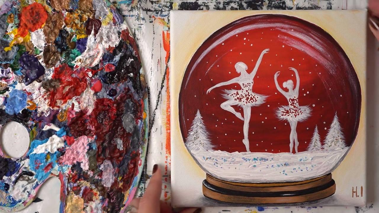 Pintura de globo de neve com bailarinas