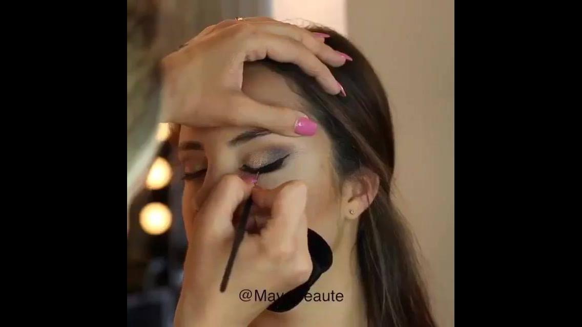 Maquiagem com olhos esfumados