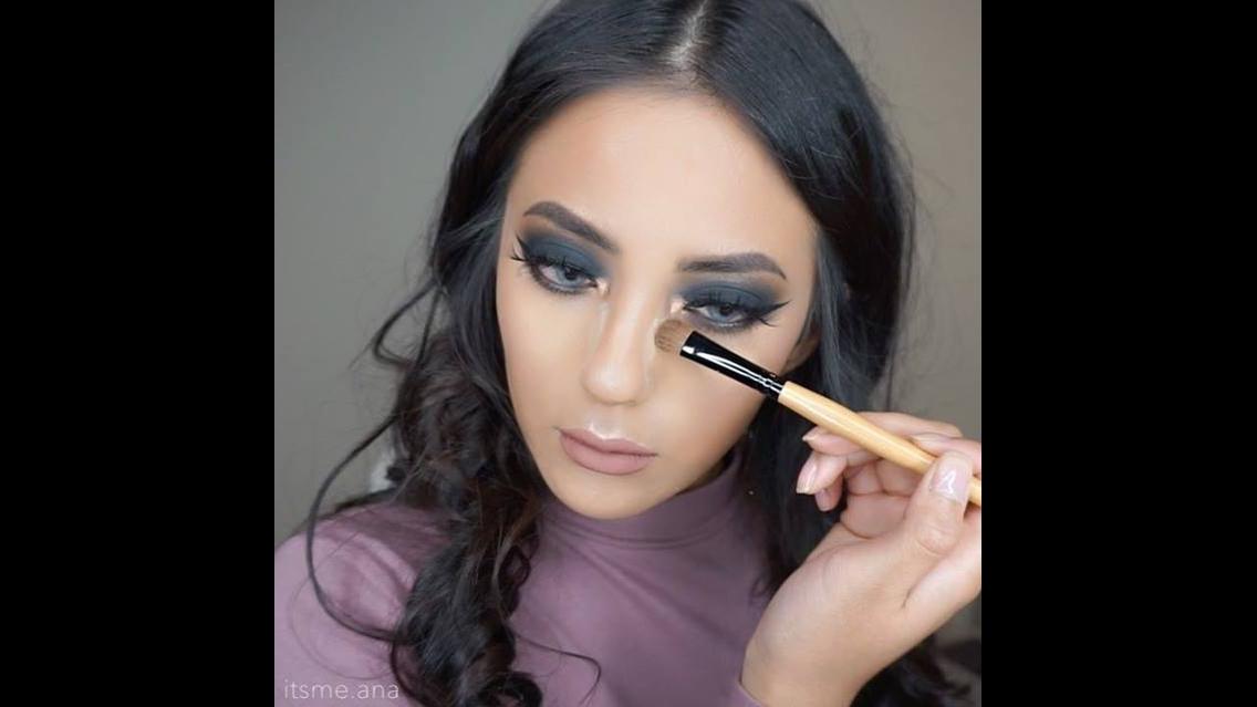 Maquiagem com sombra preta e esfumado marrom