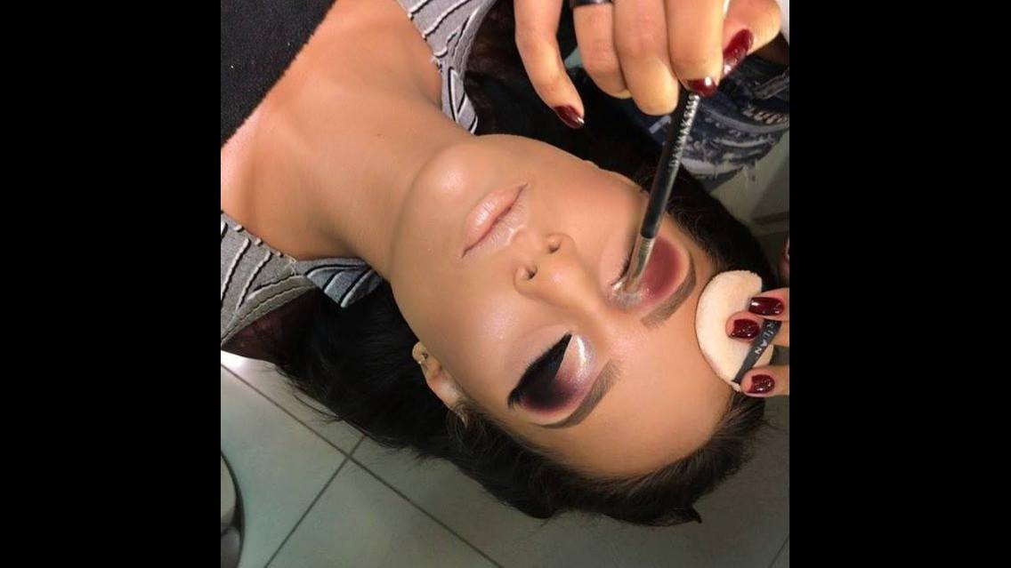 Maquiagem para formanda com sombra vermelha e esfumado preto