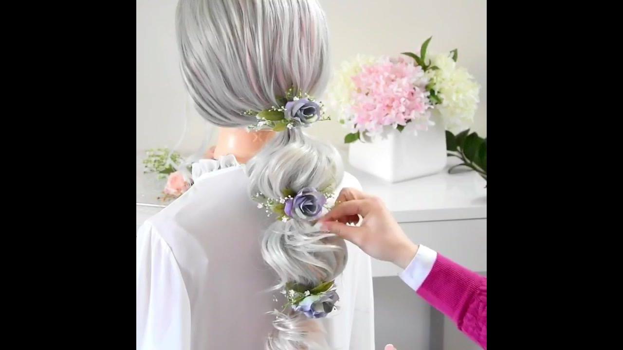 Penteado preso com flores no comprimento