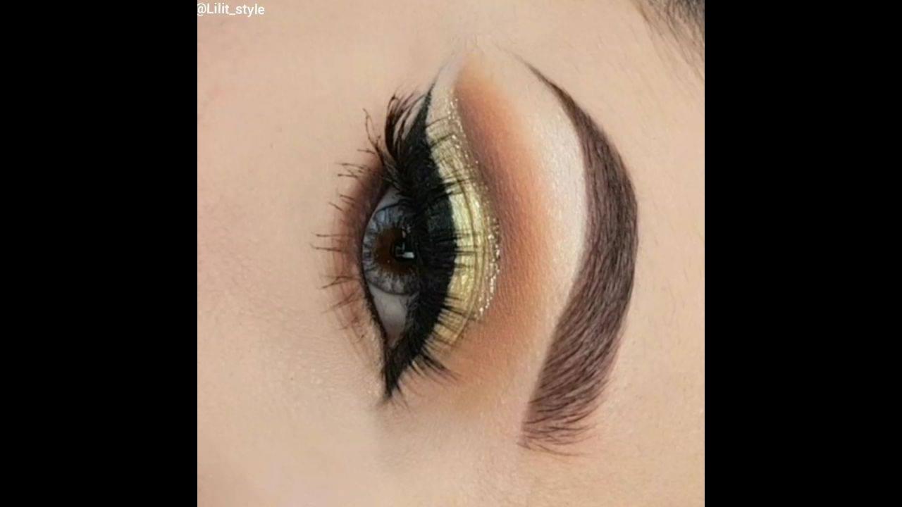 Sombra dourada com delineado preto, ficou maravilhosa essa make!