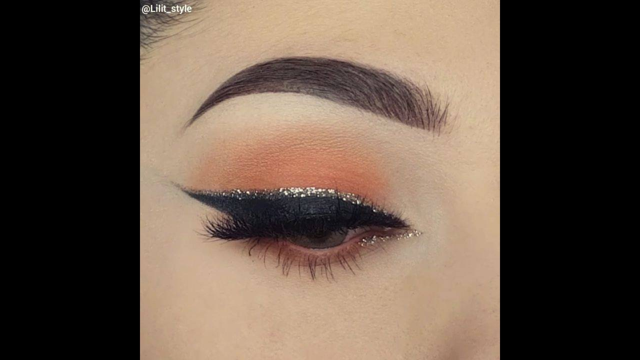 Sombra marrom com delineado preto, e detalhe de Glitter dourado!!!